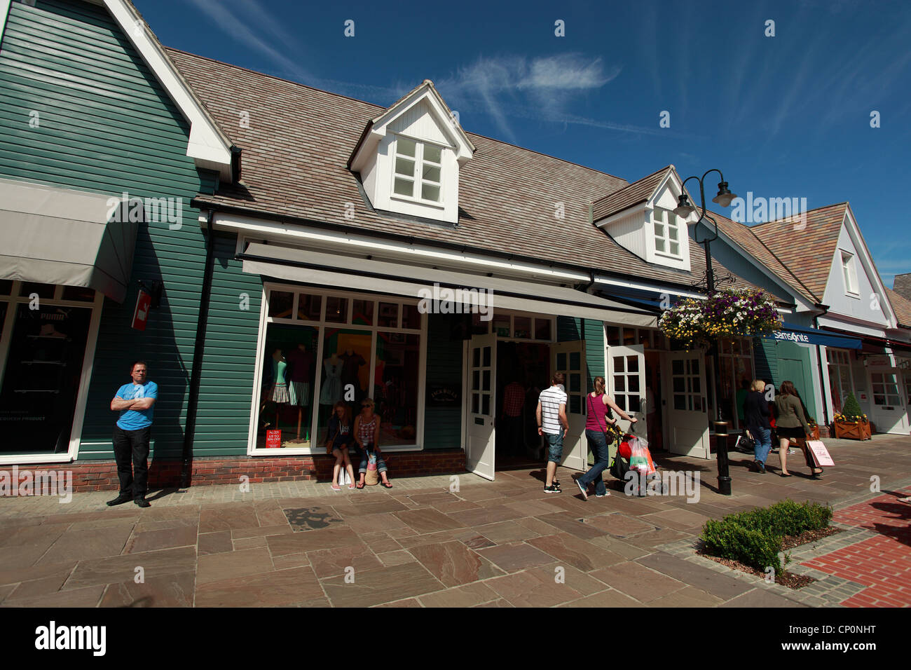 Jack Wills and Shoppers at Bicester Shopping Outlet, Oxfordshire, UK - Stock Image