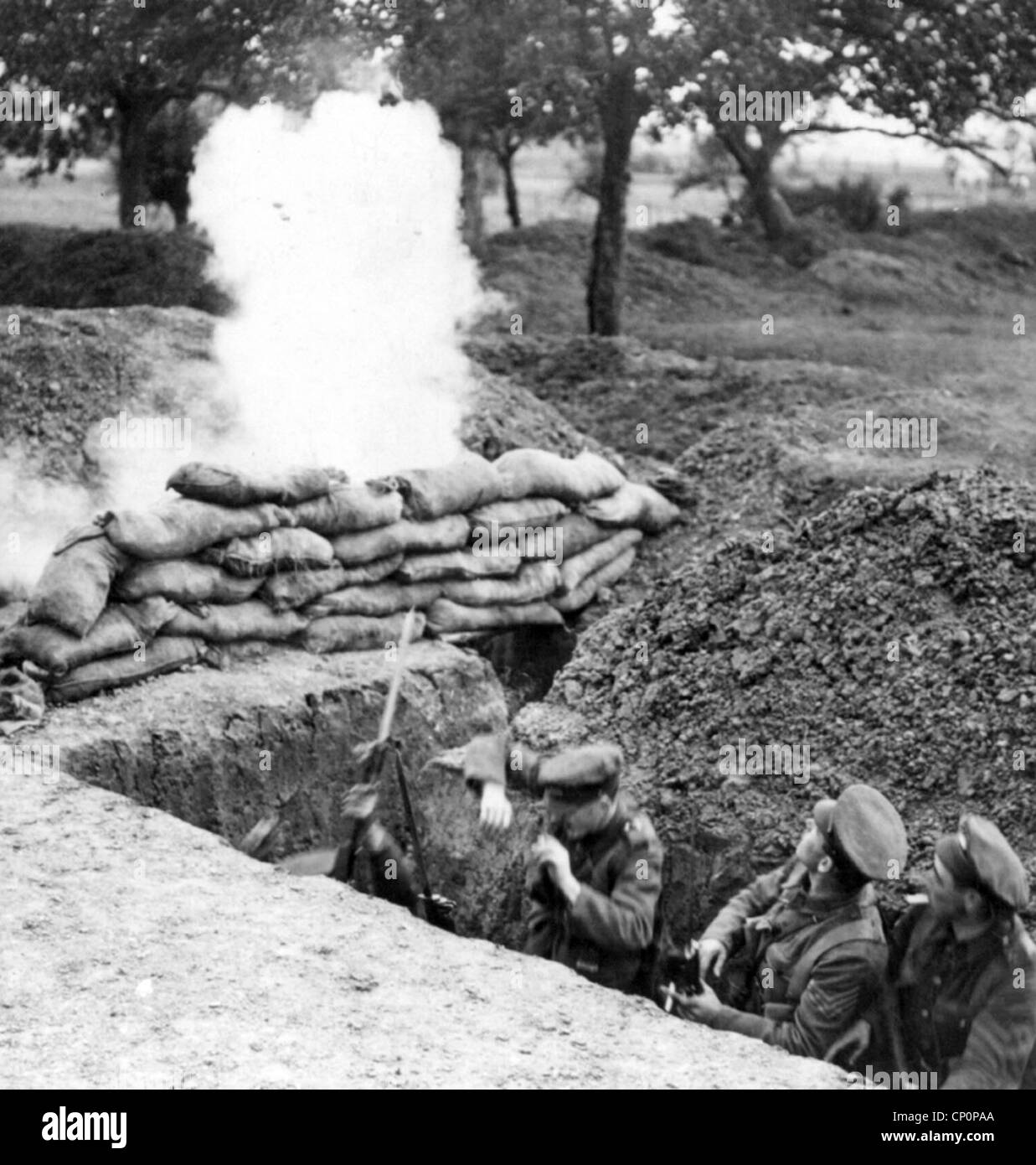 British soldiers in trench under fire during World War One - Stock Image