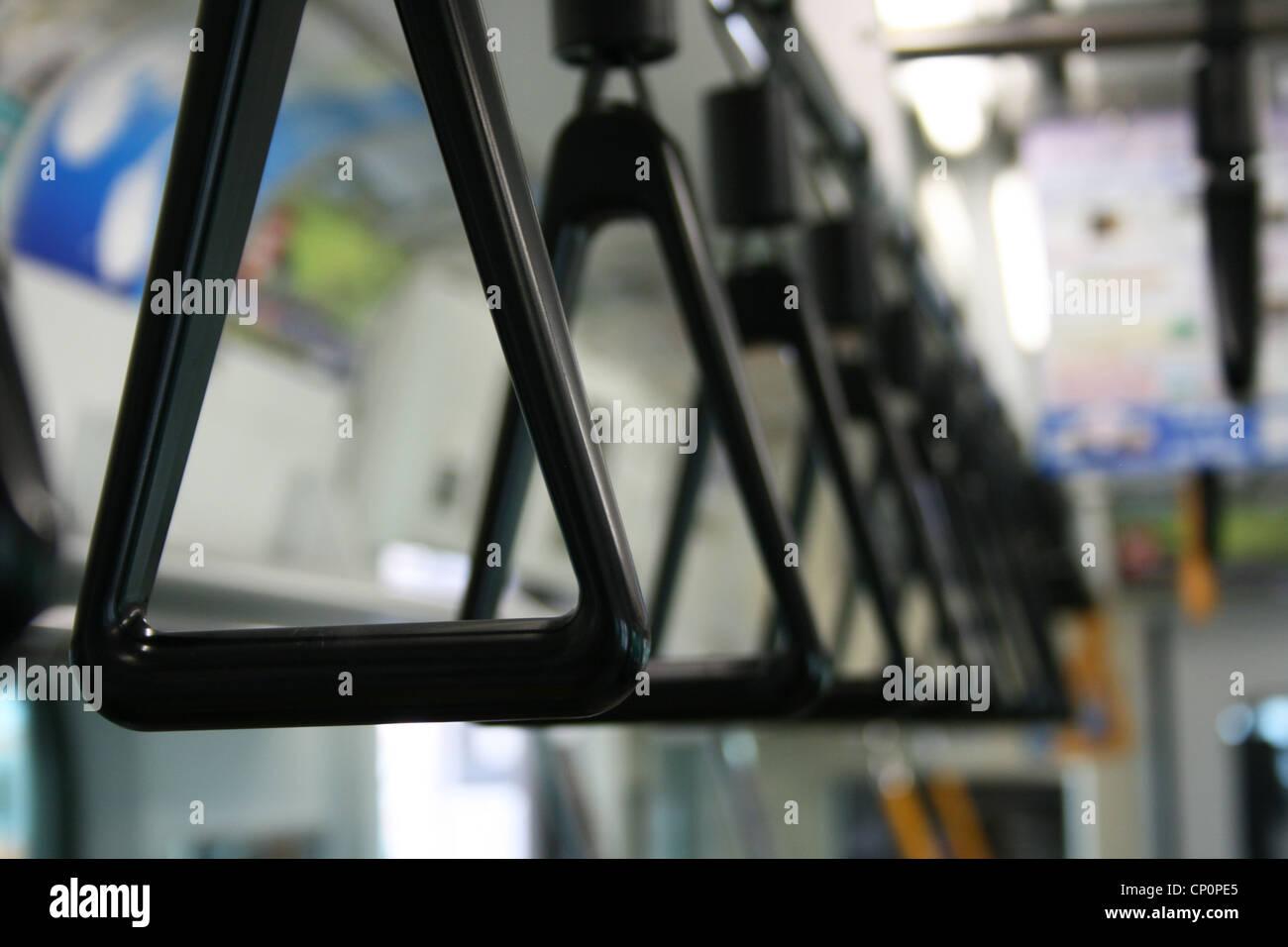 Close up of handles in a subway train, Tokyo Japan. - Stock Image