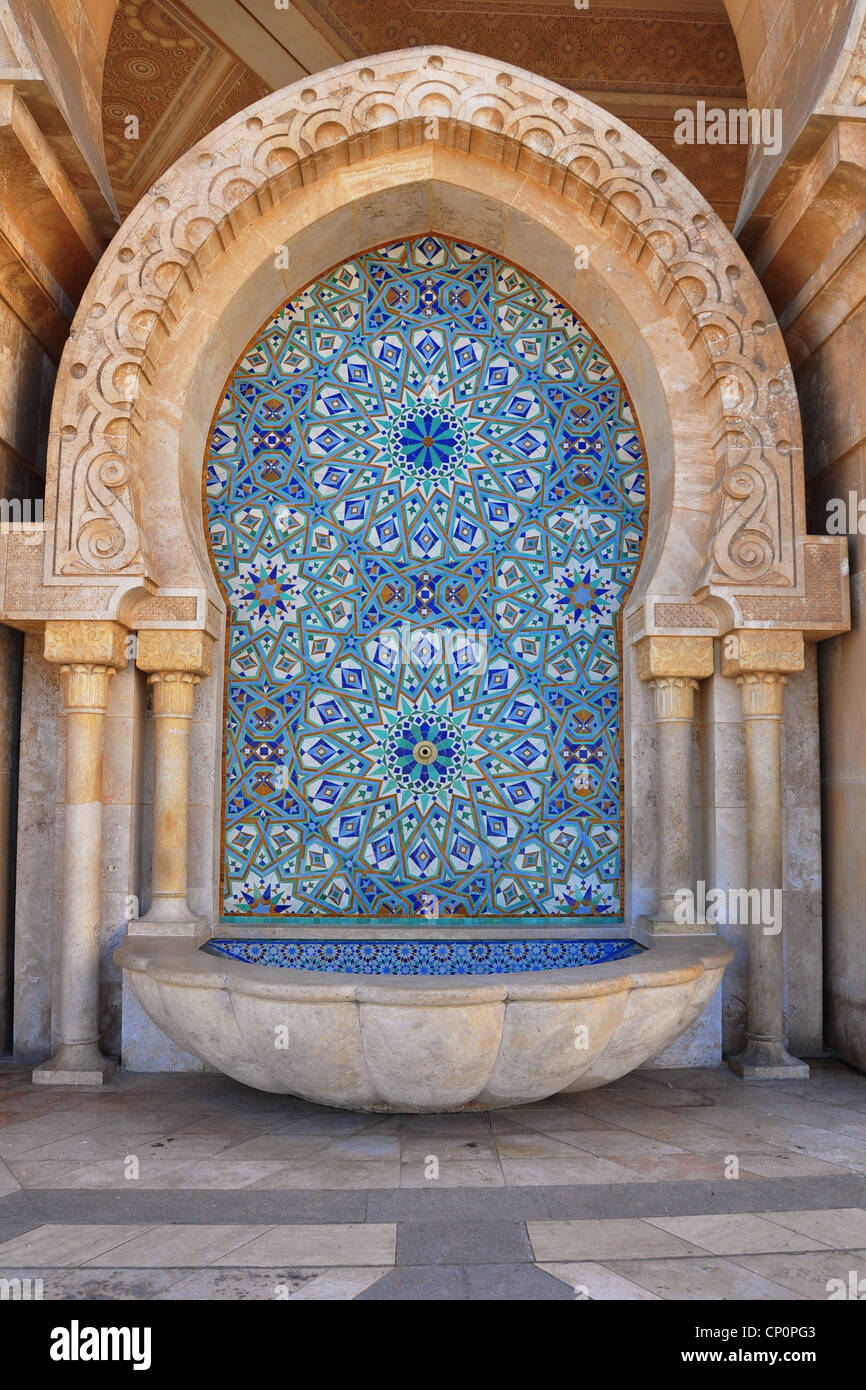 Traditional Moroccan fountain which forms part of the exterior of the King Hassan II Mosque on the Atlantic coast - Stock Image