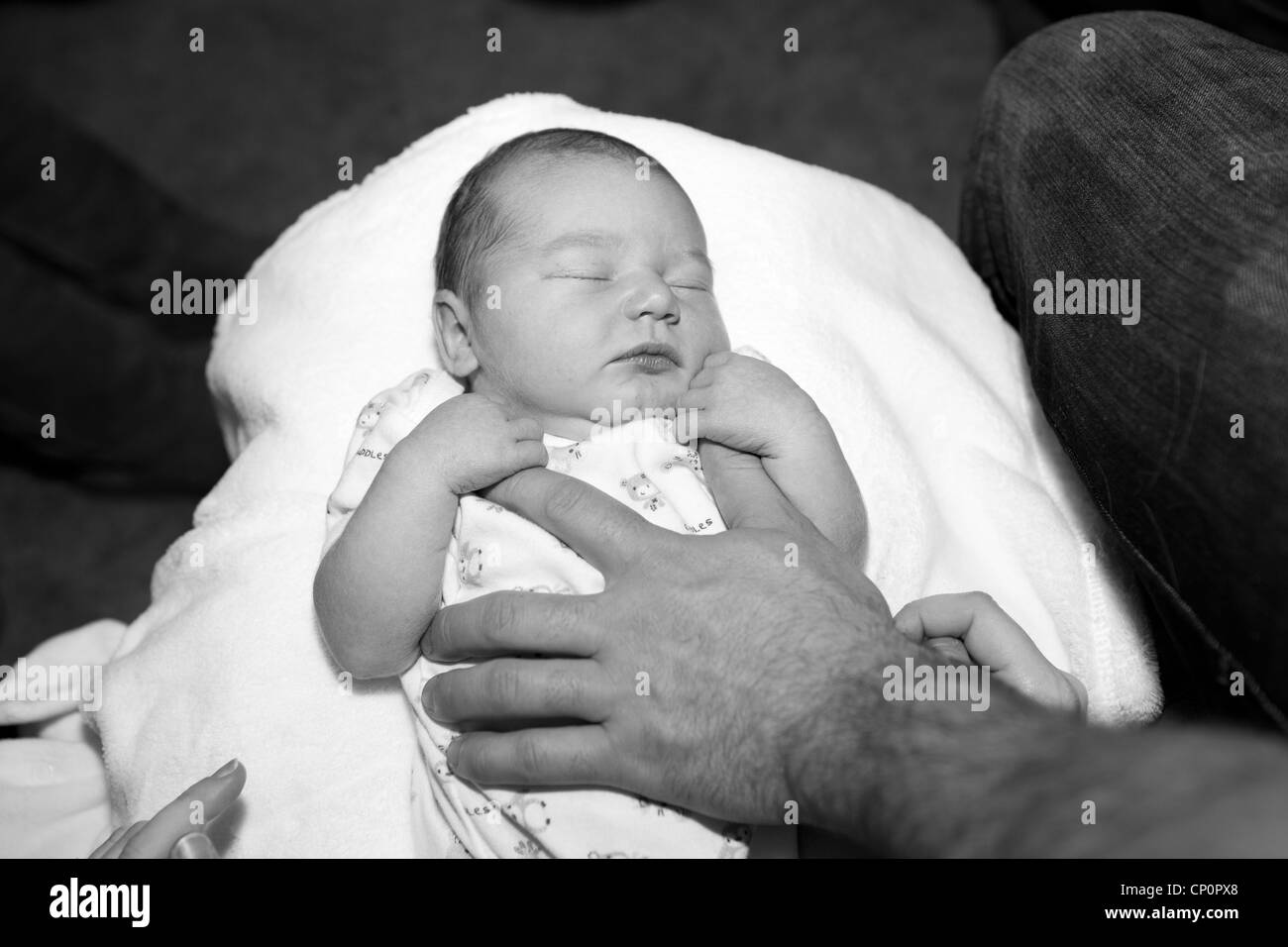 Baby in secure hands - Stock Image