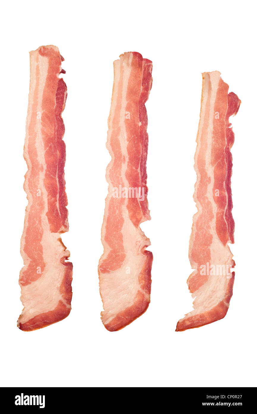Three strips of raw bacon isolated on a white background. Image is suitable for many cooking and health inferences. - Stock Image