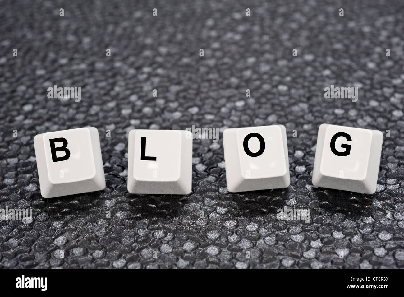 A set of computer keyboard keys spelling out BLOG. Good for Internet and technology inferences. - Stock Image