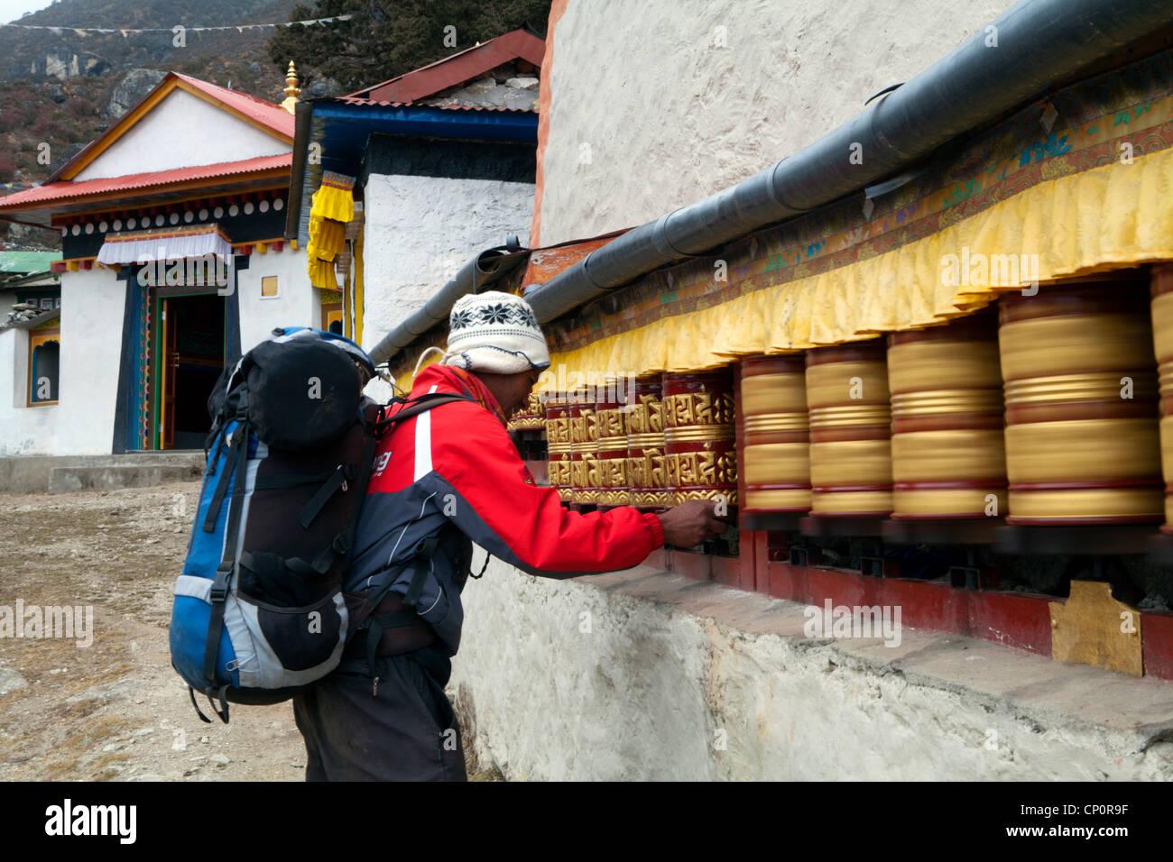 Spinning prayer wheels at the Khumjung Monastery - Stock Image