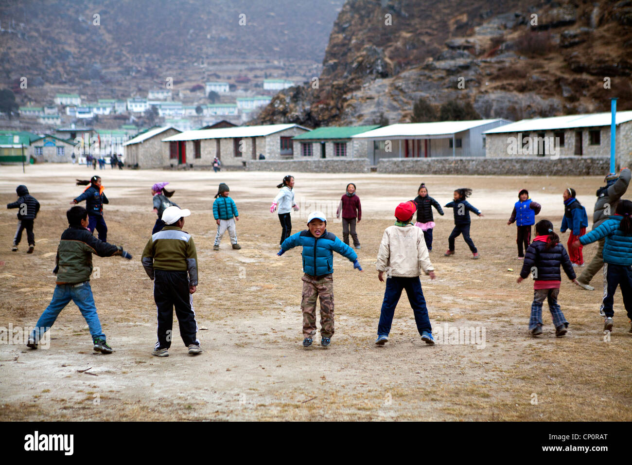 Children exercising at the Khumjung school above Namche Bazaar, built by Sir Edmund Hillary - Stock Image