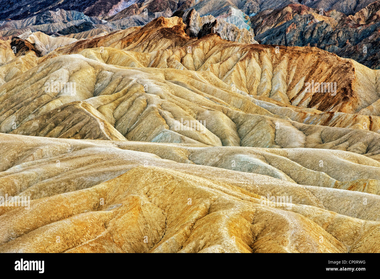 The sun baked badlands and many hues of Golden Canyon in California's Death Valley National Park. - Stock Image