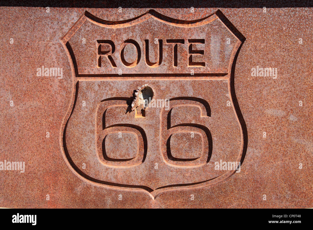 rusty steel route 66 sign with bullet hole - Stock Image