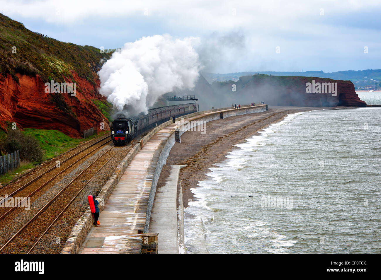 The Great Britain V double headed by 34067 Tangmere and 70013 Oliver Cromwell along the sea wall Dawlish south Devon - Stock Image