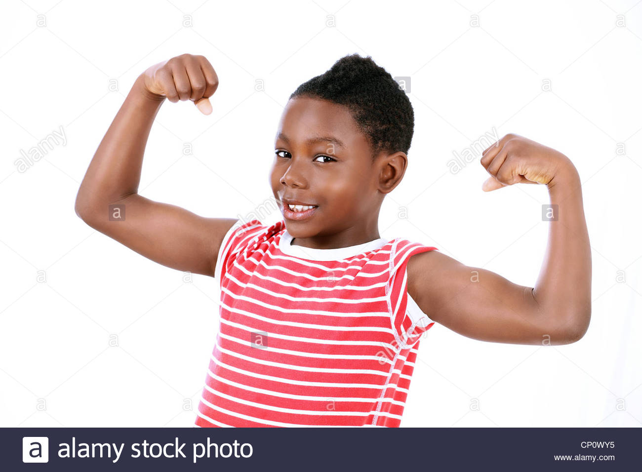 Little boy showing muscles - Stock Image
