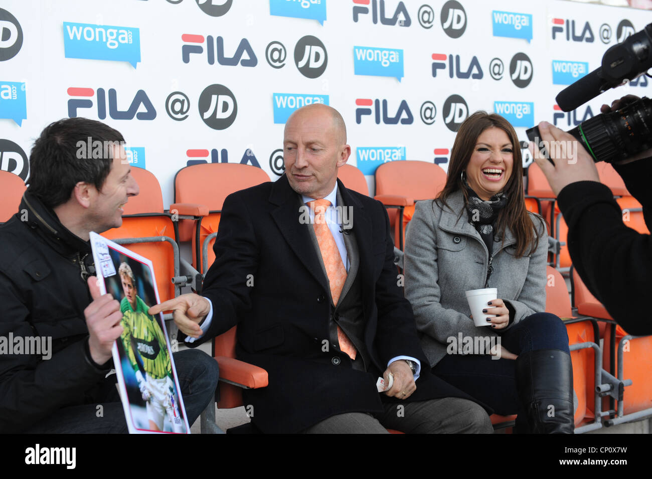 Take It Like A Fan presenters Bianca Westwood and John 'Fenners' Fendley inteviewing Blackpool manager Ian - Stock Image