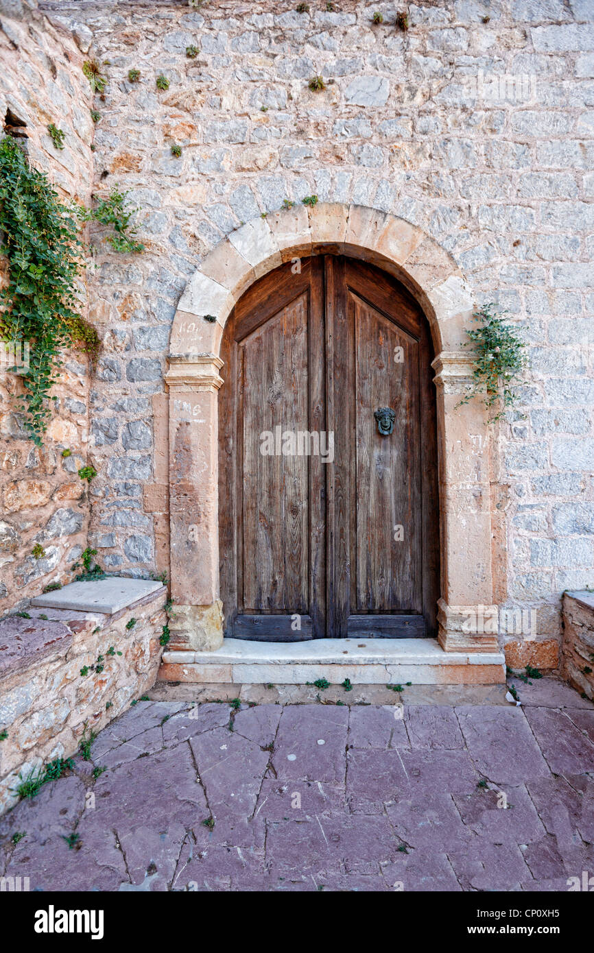 Old door of mansion at Hydra, Greece - Stock Image