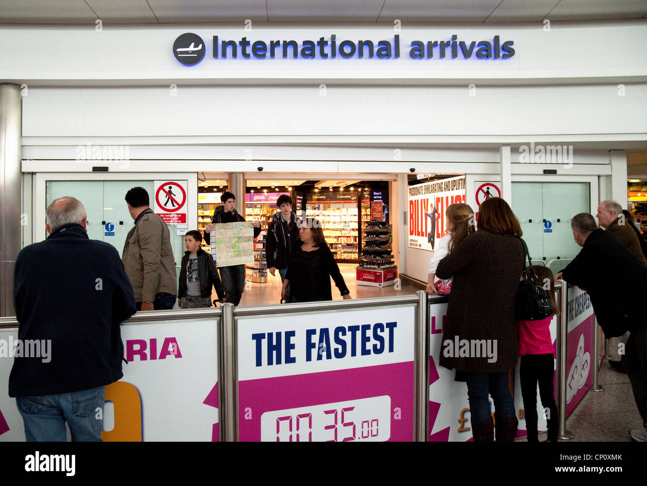 People at the International Arrivals department, Stansted Airport Essex UK - Stock Image