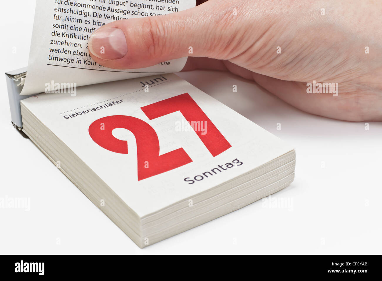 A calendar sheet is lifting and shows Sunday, June 27th. In Germany, June 27th is Siebenschläfertag (Seven - Stock Image