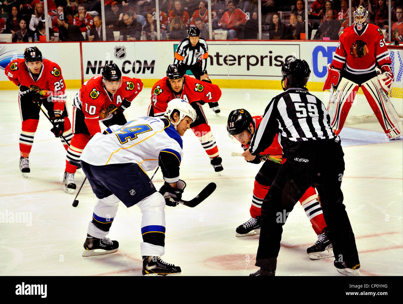 Faceoff during NHL's Chicago Blackhawks and St. Louis Blues. - Stock Image