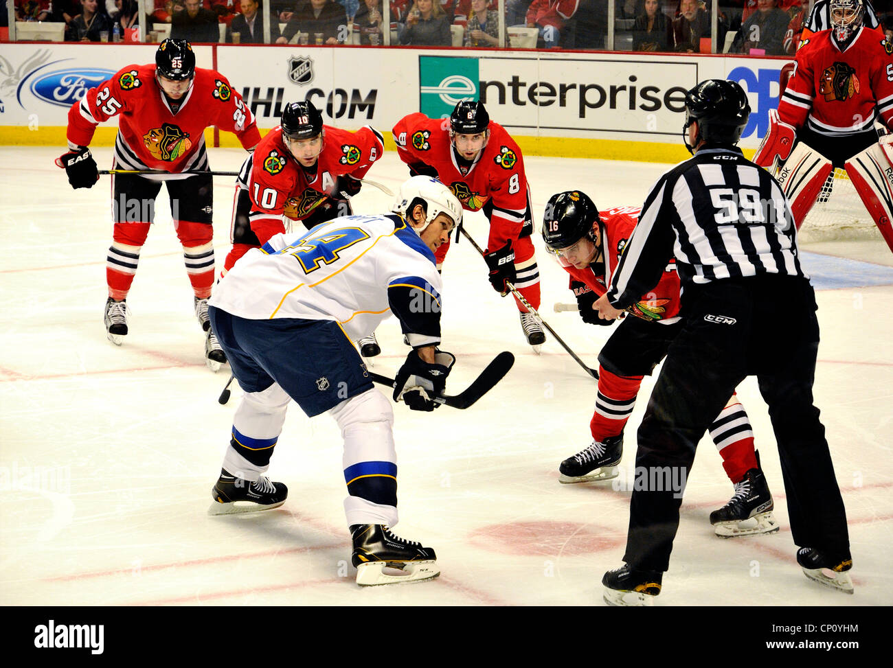 Faceoff during NHL's Chicago Blackhawks and St. Louis Blues.Faceoff during NHL's Chicago Blackhawks and - Stock Image