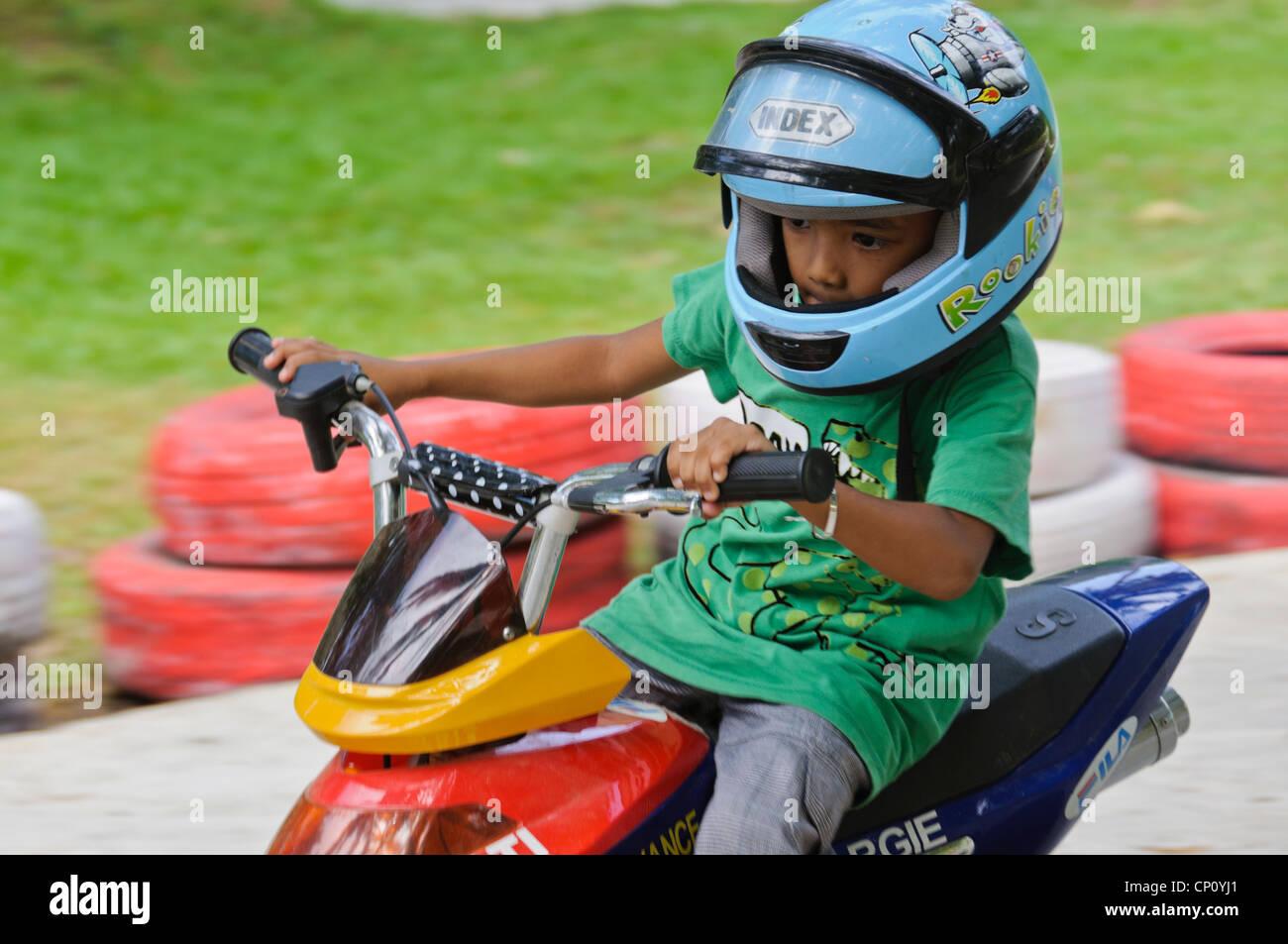 Young 4 5 Years Boy Blue Helmet Riding Children Atv Quad Racing On Stock Photo Alamy