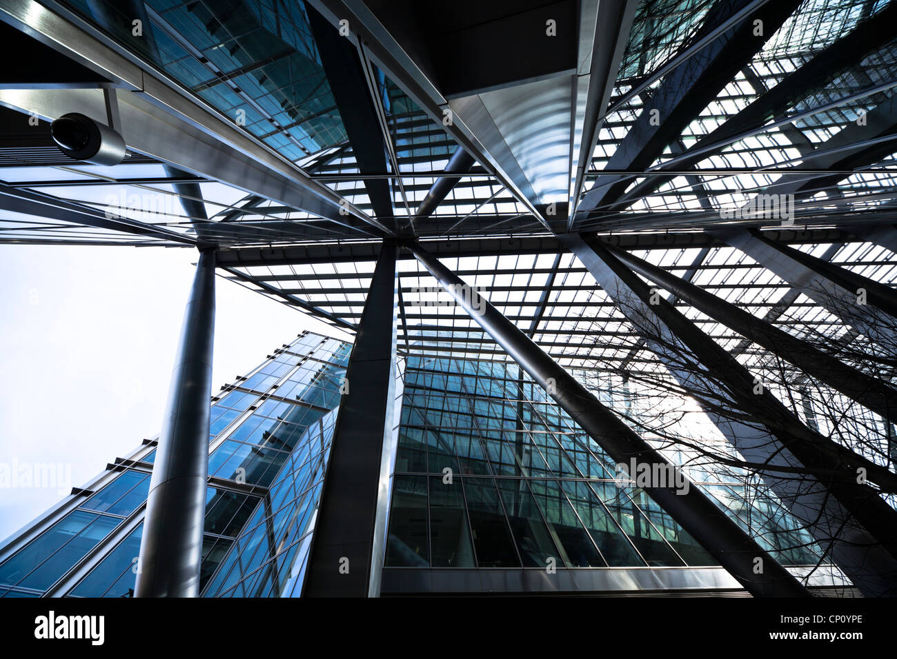 Reflections and patterns formed by modern architecture in the Broadgate Tower, Bishopsgate, London - Stock Image