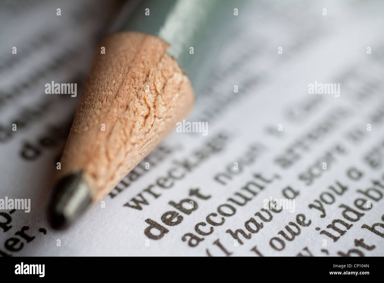 Debt the word debt in dictionary with pencil Stock Photo