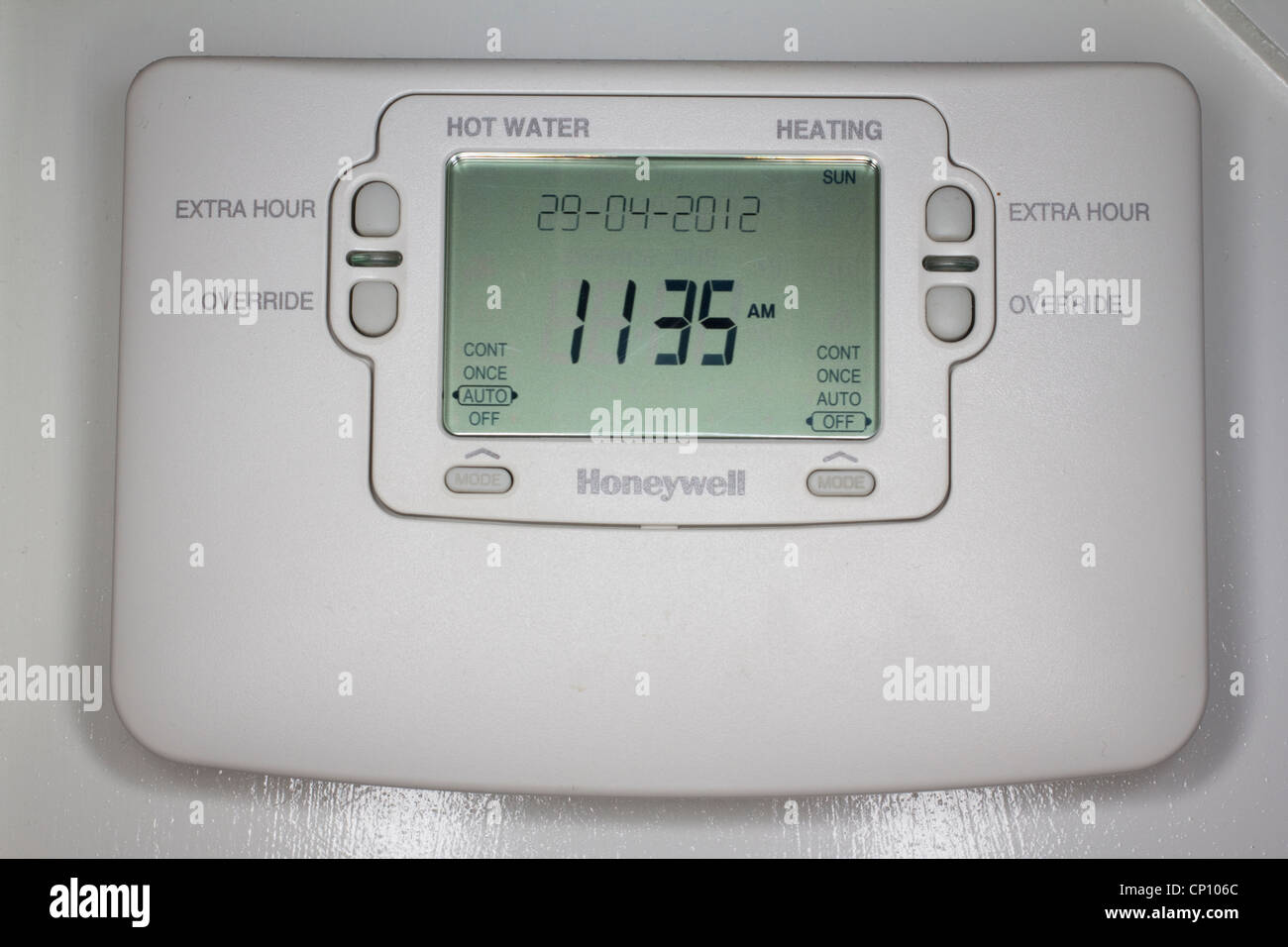 household honeywell central heating programmer timer on wall in residential property - Stock Image
