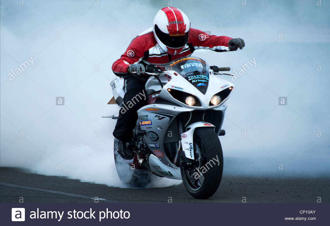 BARC motorbike races held at croft in Darlington UK.lone rider, burning rubber after winning the race. - Stock Image