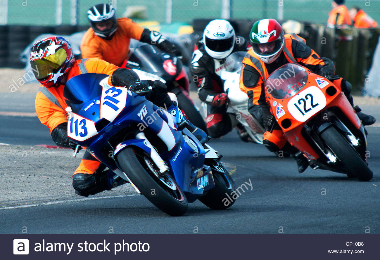 Novice race, at the BARC Superbike races held at croft in Darlington UK.Four motorbike riders rounding the final - Stock Image