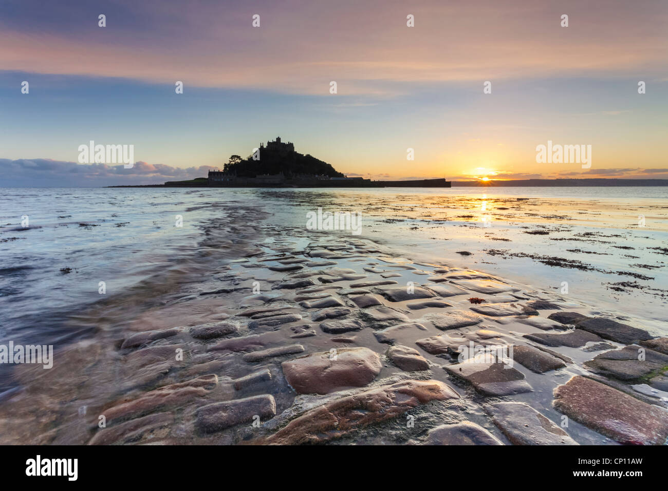 The causeway to St Michael's Mount captured at sunset - Stock Image