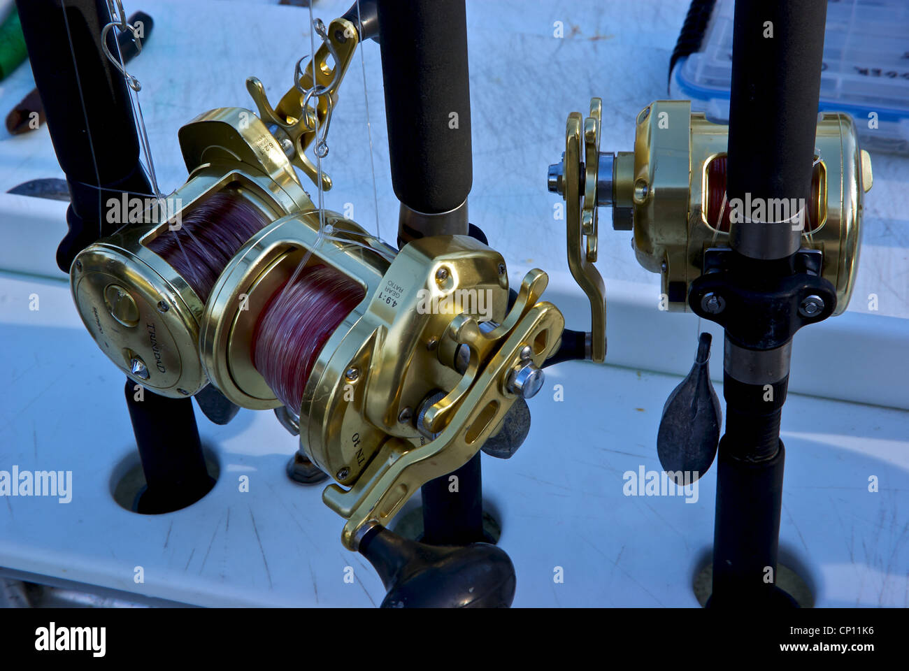 Shimano deepsea Trinidad heavy duty fishing reels rods weights barbed circle hooks - Stock Image