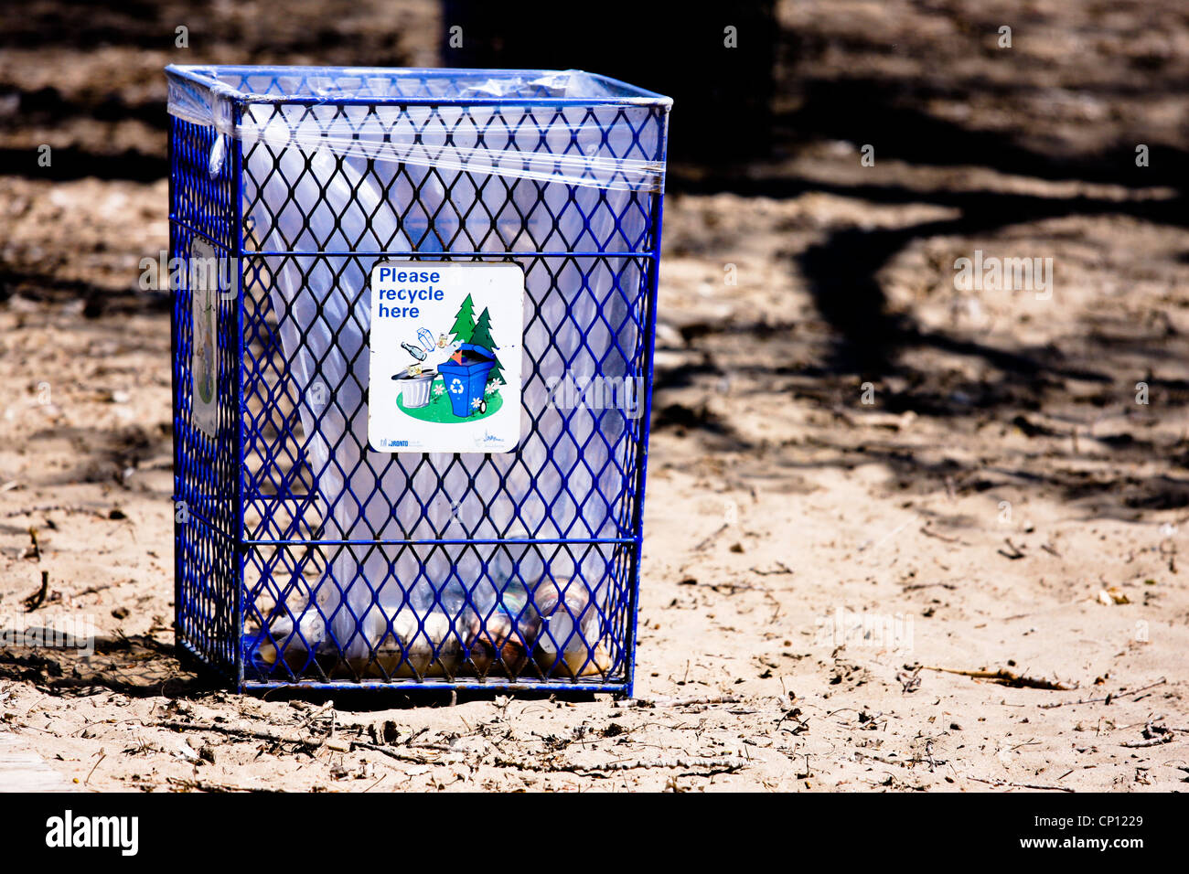 outdoor garbage can beach - Stock Image