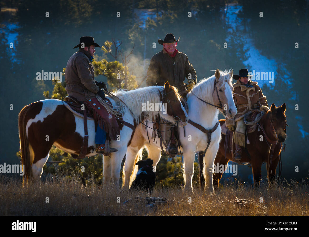 Cowboys on horseback in northeastern Wyoming Stock Photo