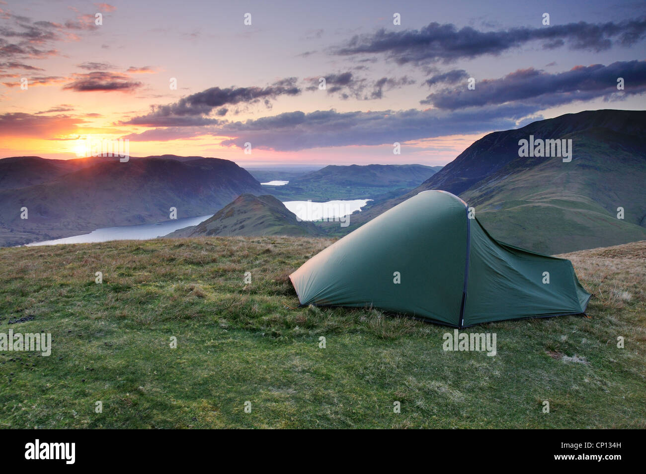 Wild Camping at sunset on High Snockrigg, Robinson, above Buttermere and Crummock Water in the English Lake District - Stock Image