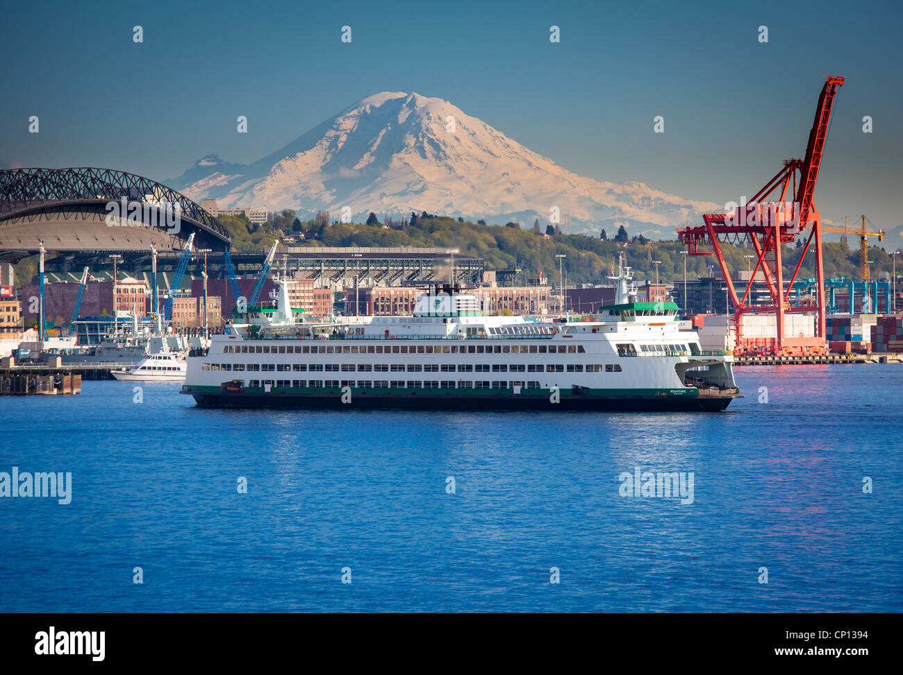 Washington state ferry in Seattle harbor with Mount Rainier in the distance - Stock Image