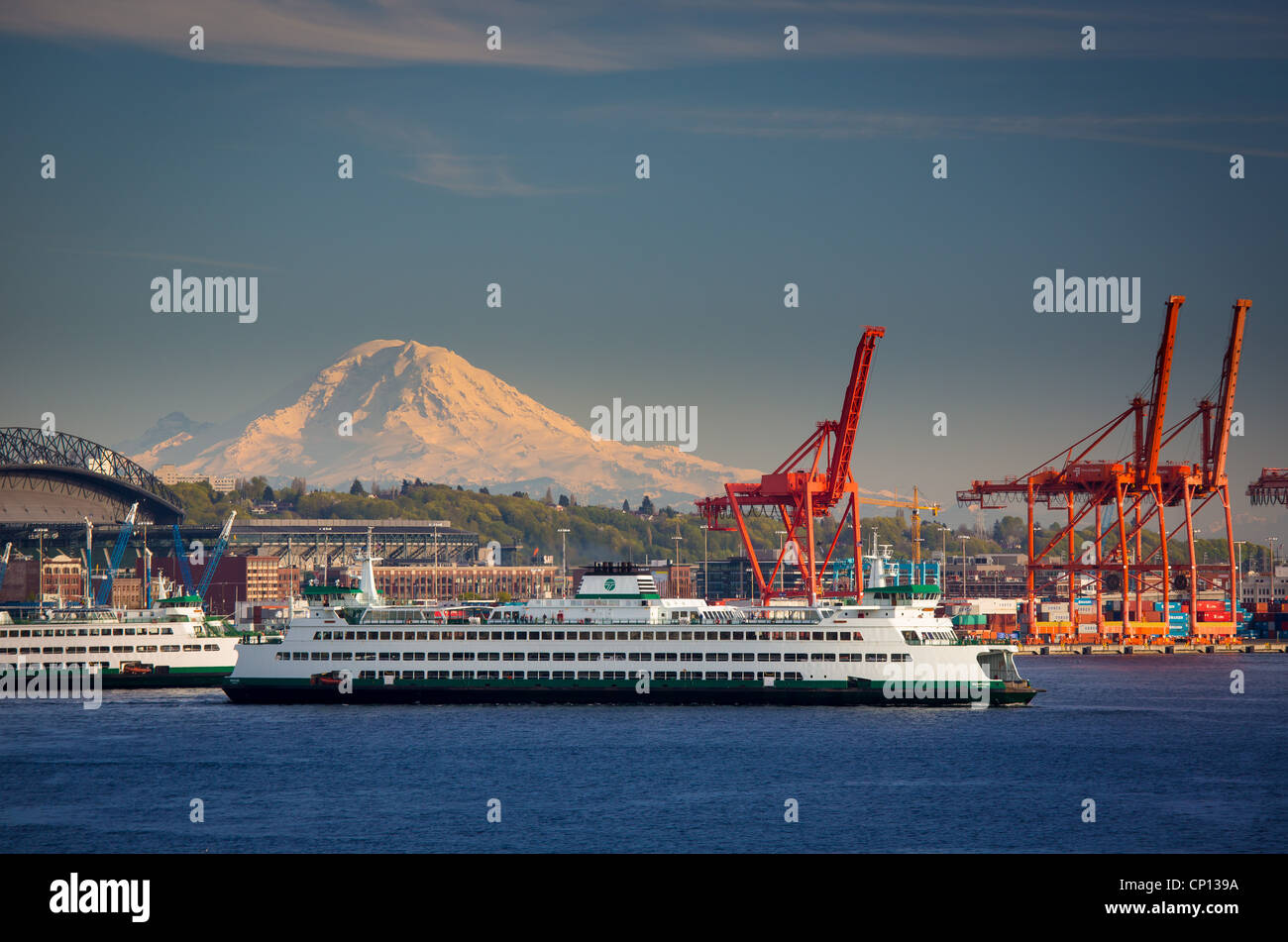Washington state ferry in Seattle harbor with Mount Rainier in the distance Stock Photo