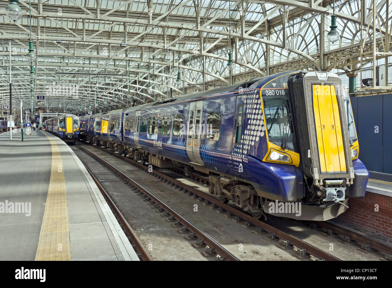 New Scotrail Class 380 EMU in Glasgow Central Station at platforms 12 and 13 - Stock Image
