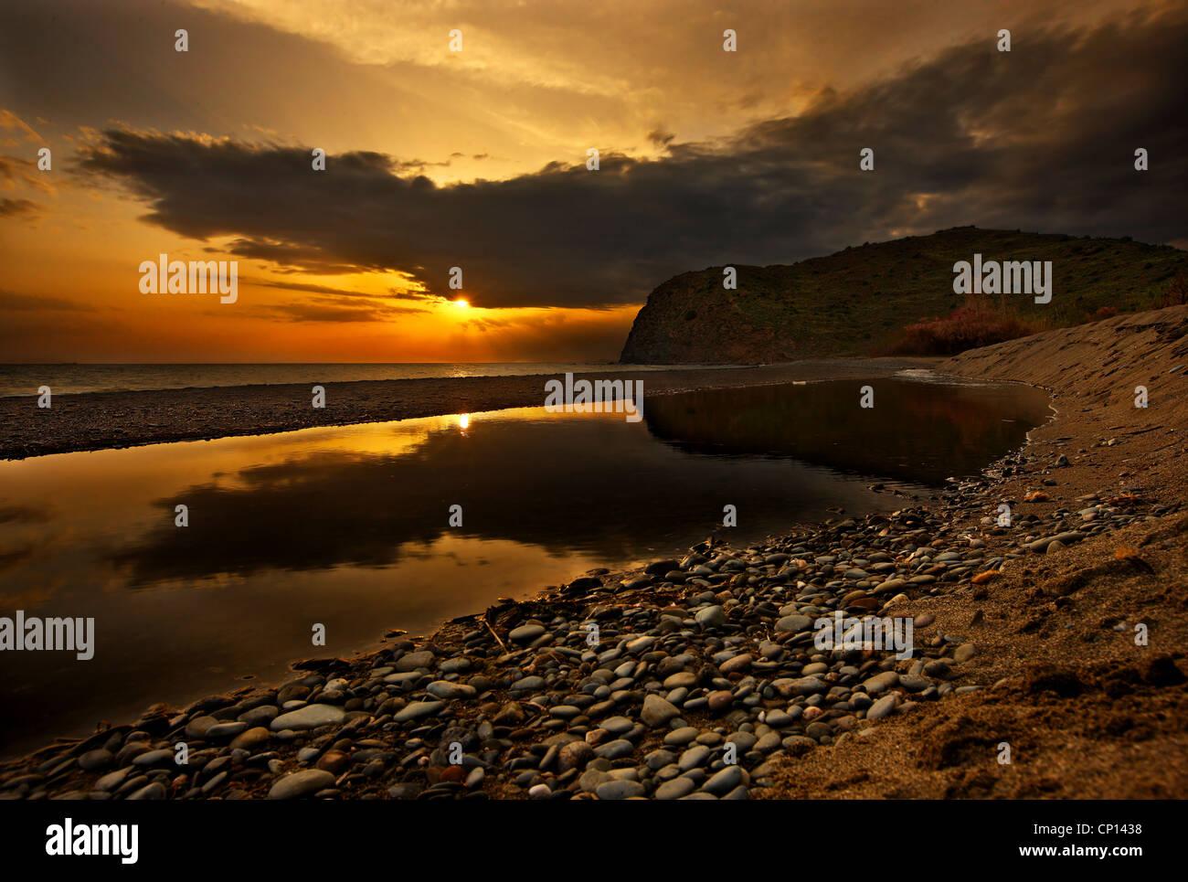 Sunset at Agia Markella beach, close to Volissos, Chios island, Northeast Aegean, Greece - Stock Image