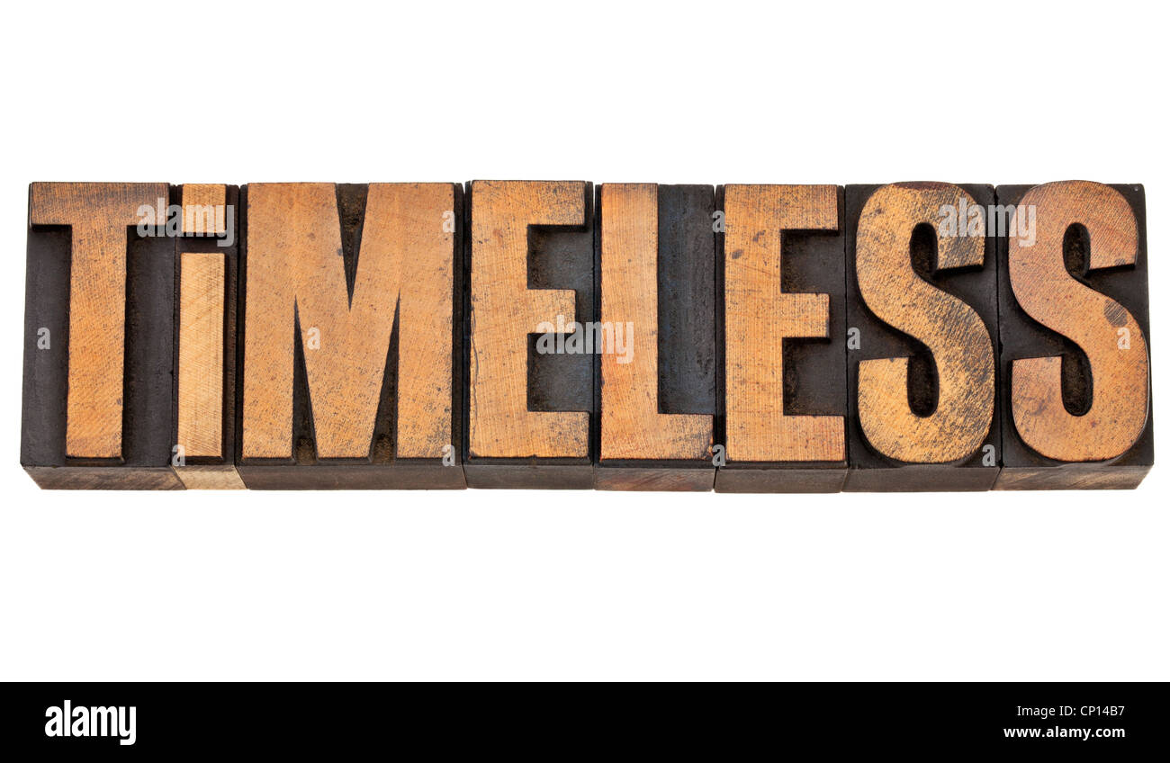 timeless - isolated text in vintage letterpress wood type - Stock Image