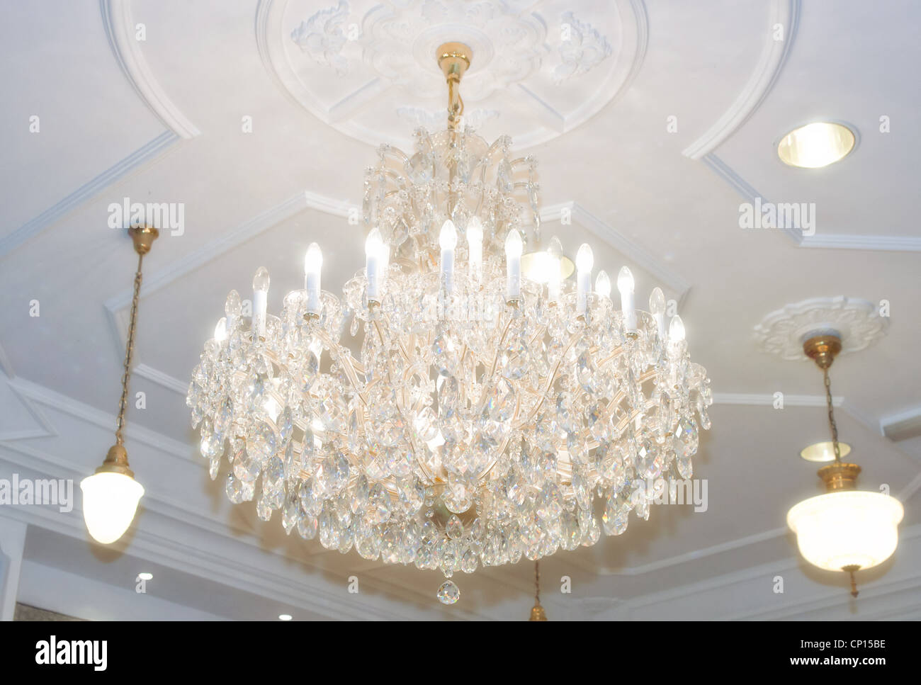 beautiful crystal chandelier hangs from the ceiling - Stock Image