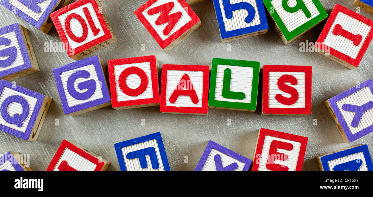 Wooden blocks forming the word GOALS in the center - Stock Image