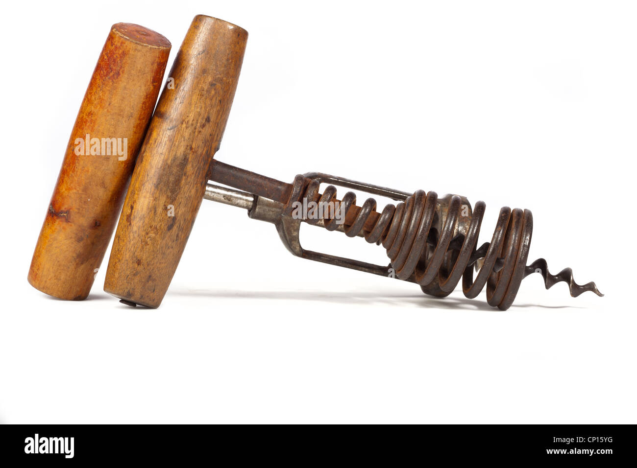 Two old corkscrews with wooden grip on white background - Stock Image