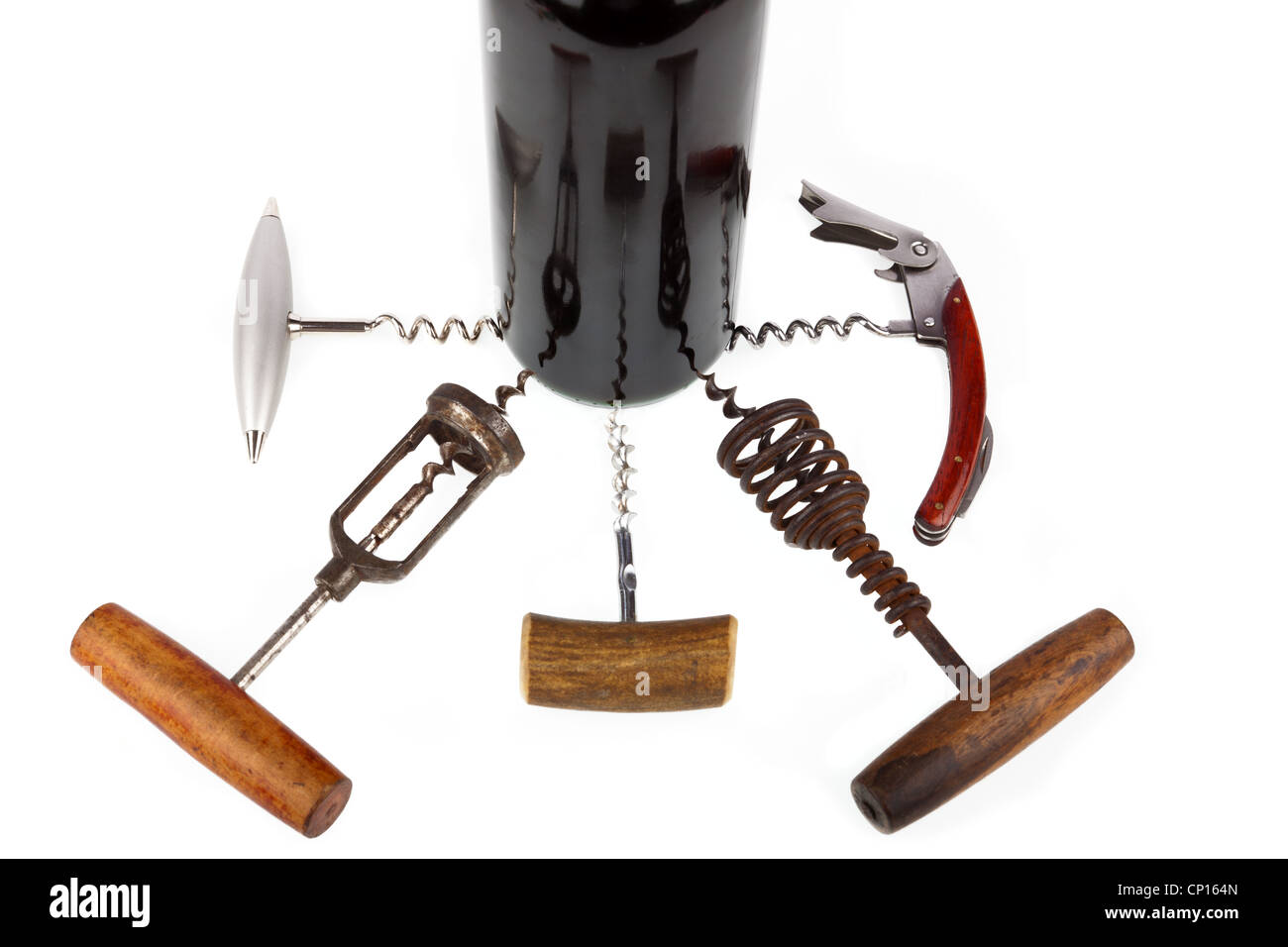 Some are different corkscrews around a wine bottle - Stock Image