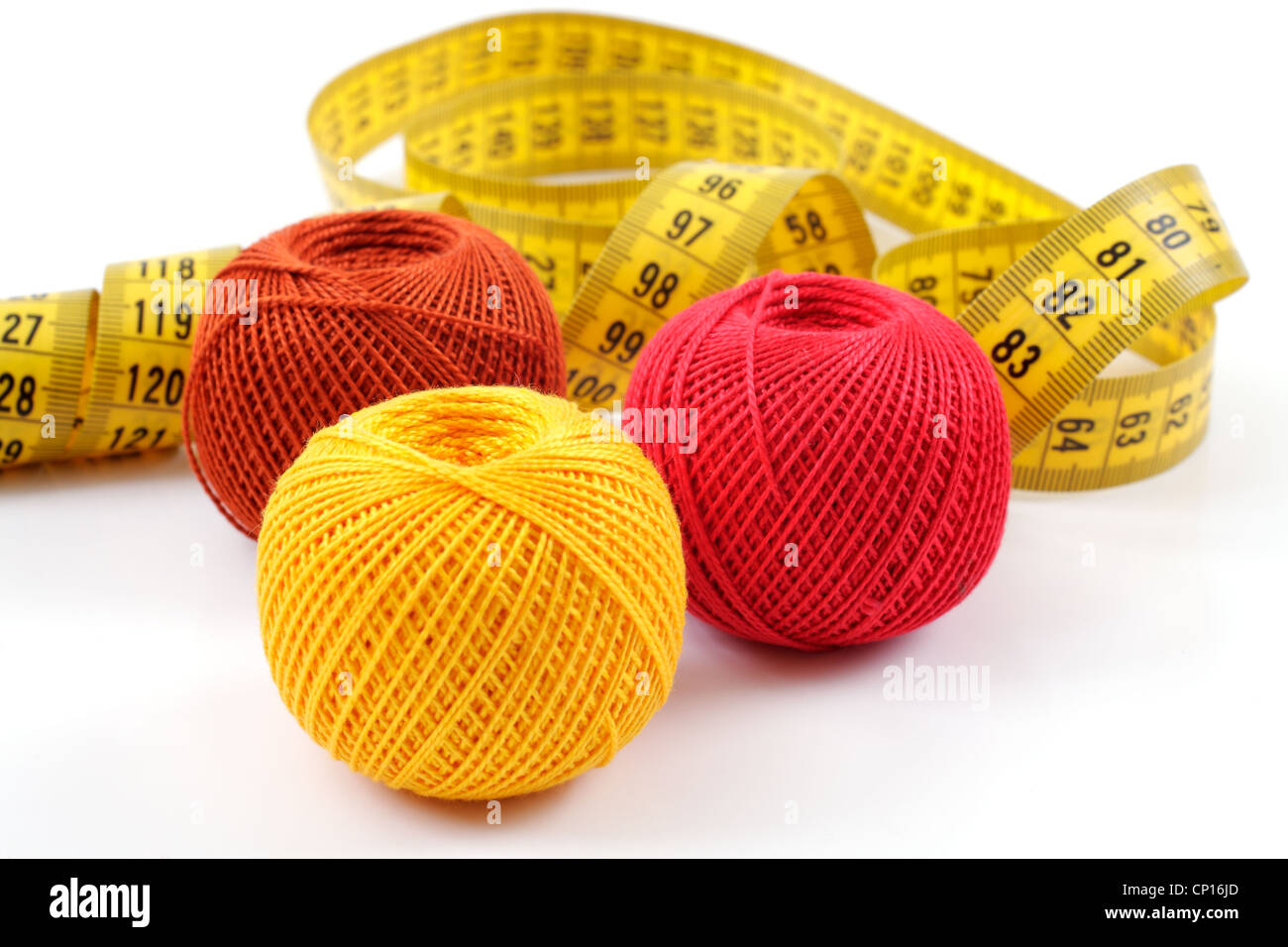 yarn and centimeter on a white background - Stock Image