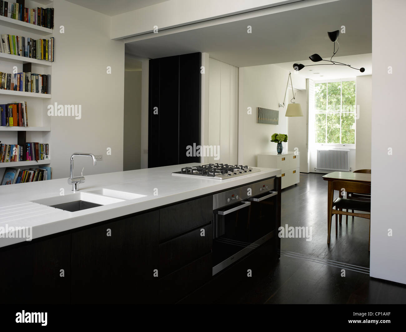 Dual aspect kitchen living room in Bayswater apartment, London, UK. - Stock Image
