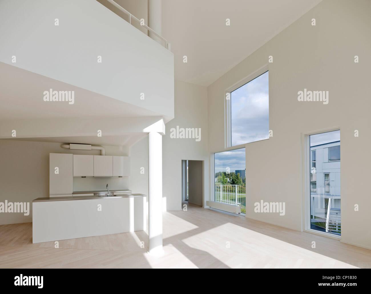 Spacious double height interior in the Trekroner Housing Development ...