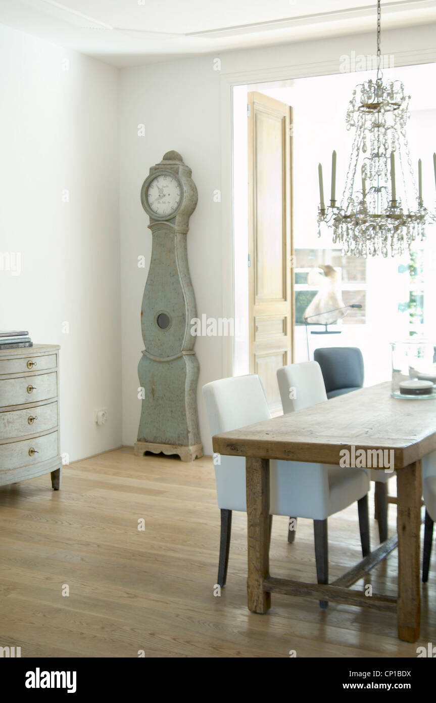 Glass Chandelier Above Dining Table With Traditional Scandinavian Clock,  Corien, The Hague, Netherlands.