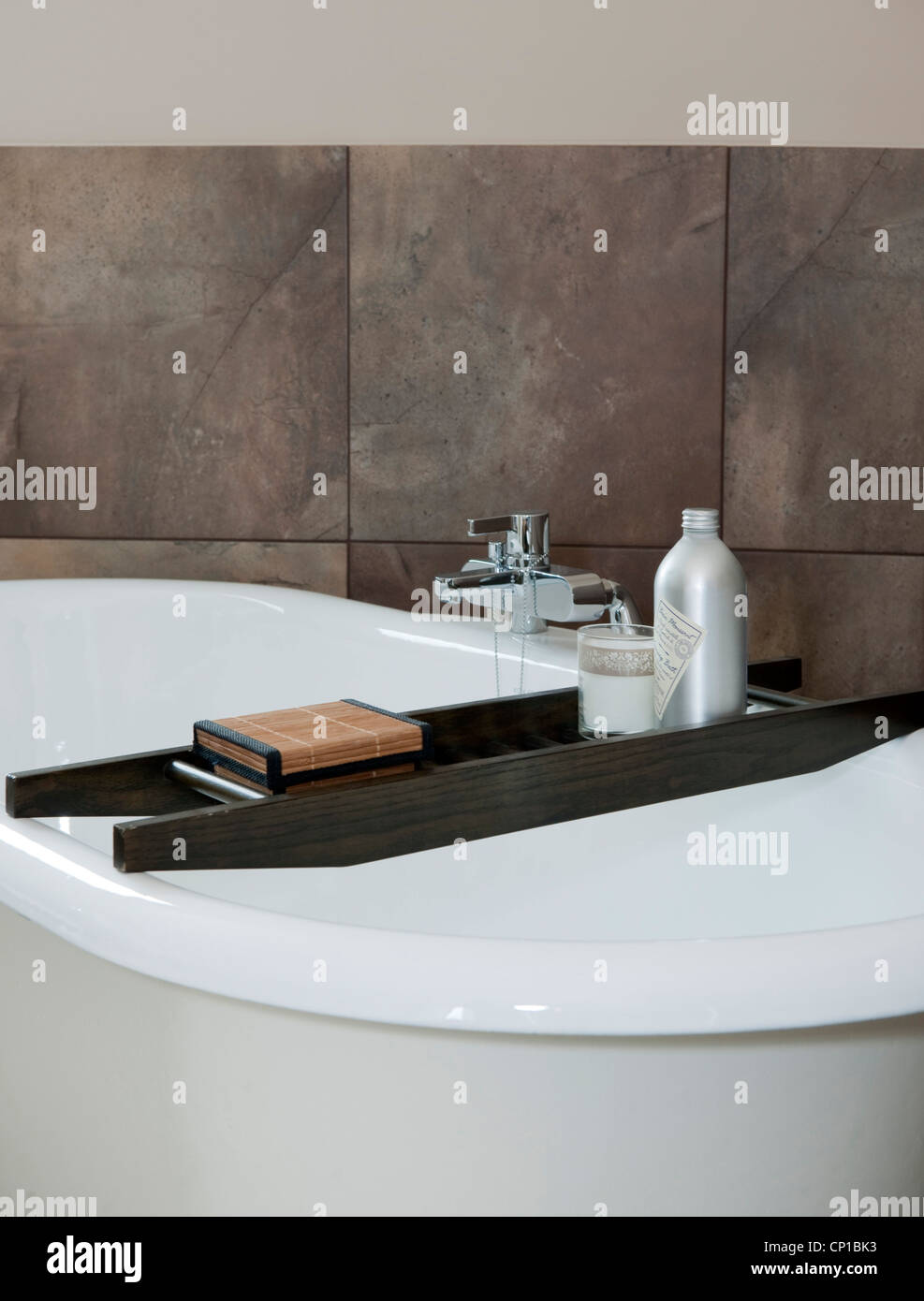 Wooden bath rack on rolltop bath in The Lakes, UK Stock Photo ...