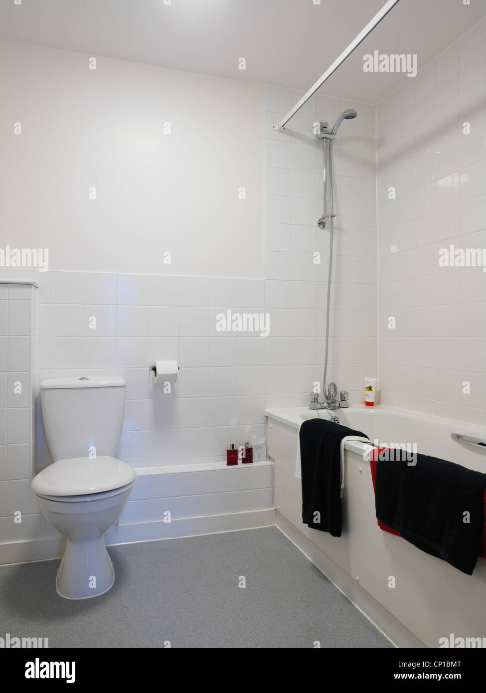 White tiled bathroom in new build social housing, East Thames ...