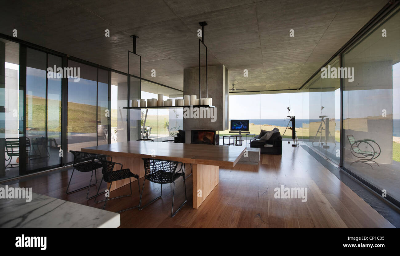 Open plan dining area with internal chimney flinders house john bornas melbourne victoria australia