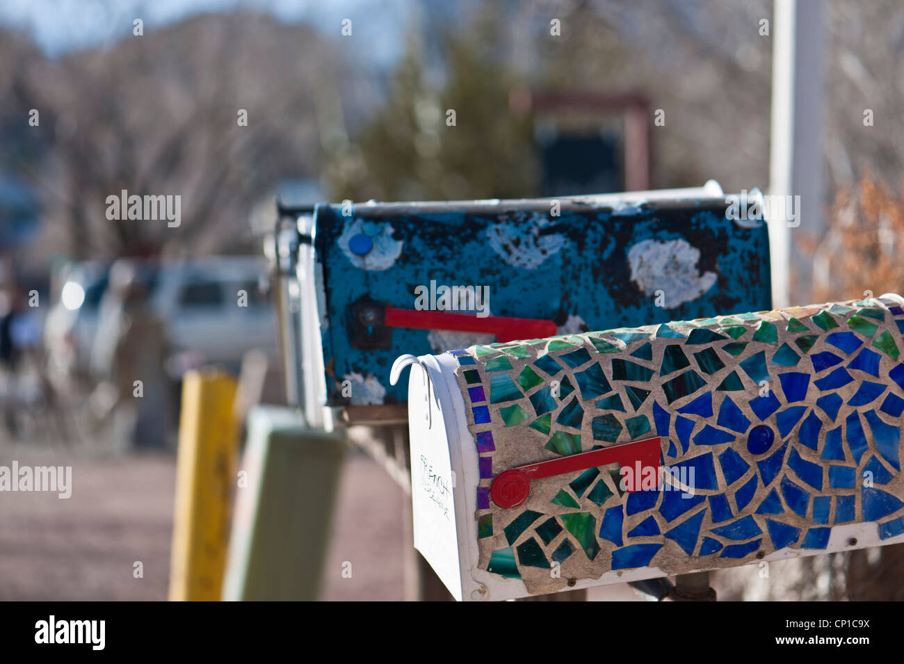 Detail of brightly decorated US style mailboxes in Madrid, New Mexico. Stock Photo