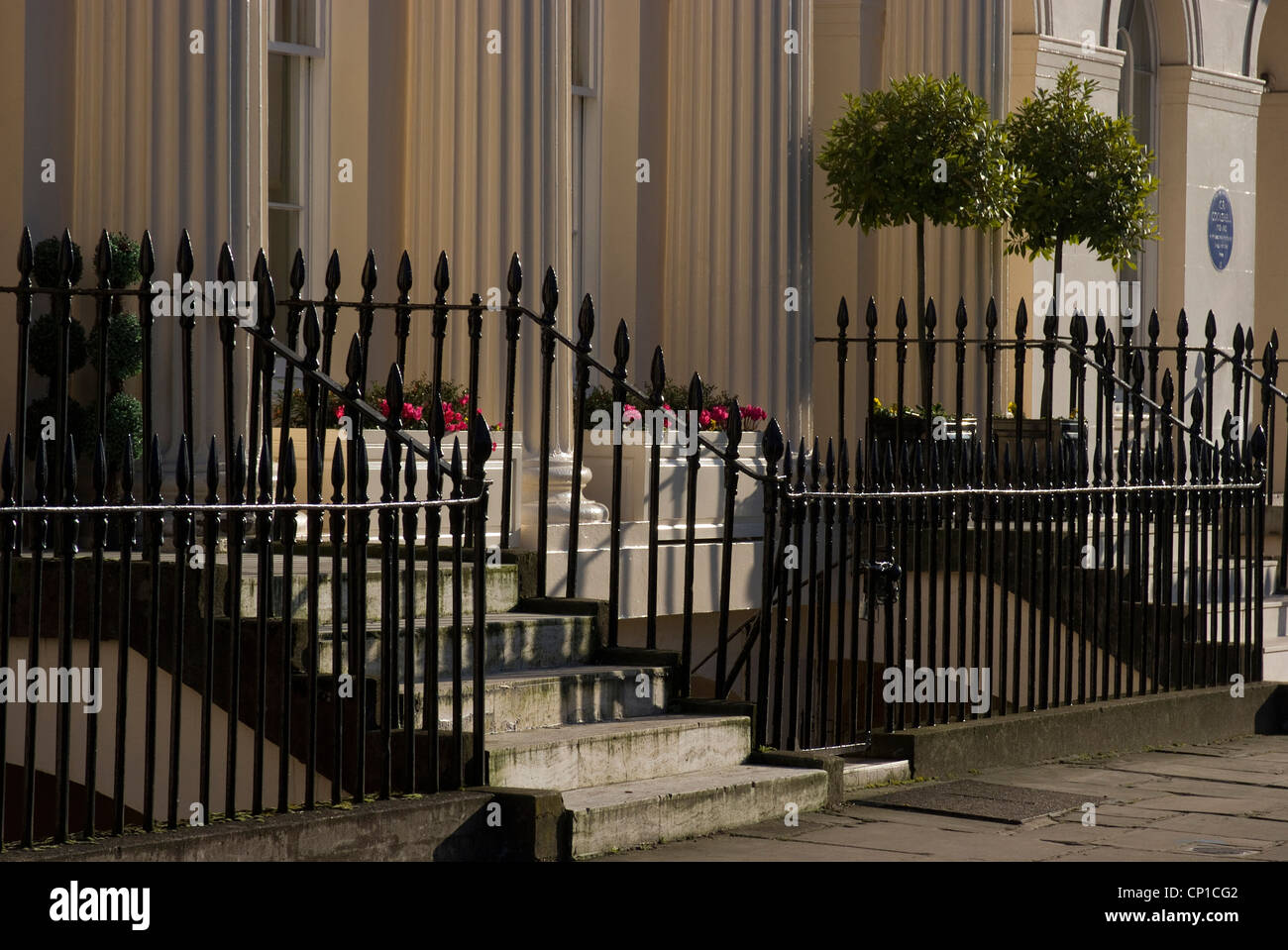 Neo-classical columns and iron gates of one of the houses of Chester Terrace, Regent's Park, Camden, London, - Stock Image