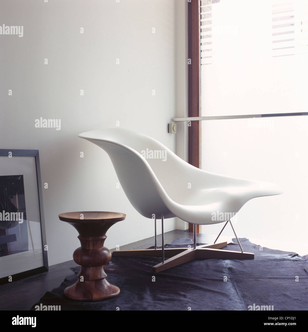 Charles And Ray Eames Le Chaise Next To Window   Stock Image