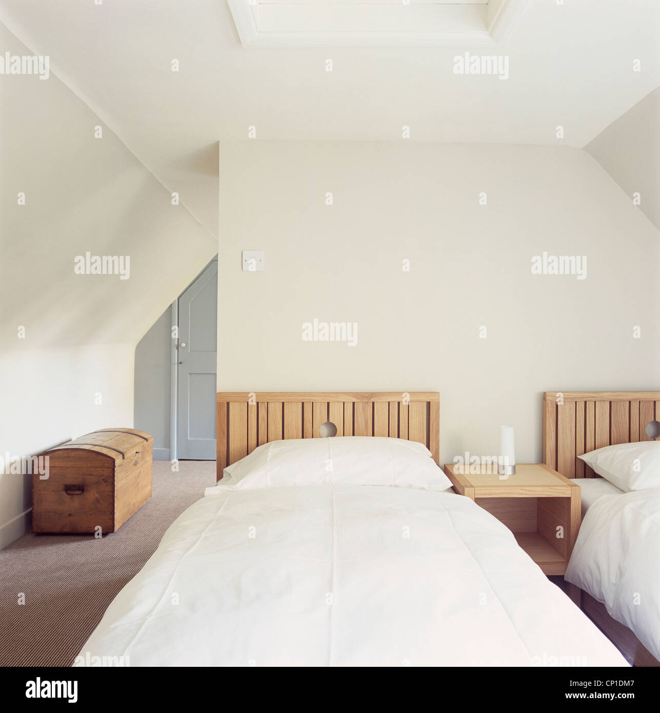 Picture of: Pair Of Wooden Single Beds In Modern White Bedroom Stock Photo Alamy